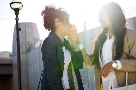 black teens: telling a secret to her sister