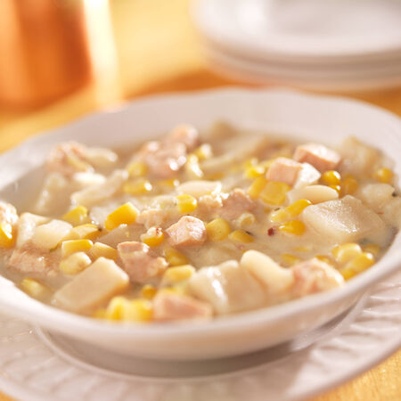 chowder: bowl of corn chowder shot with selective focus.