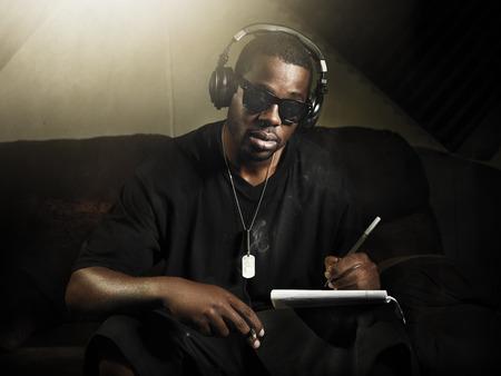 cool dj writing music in recording studio photo