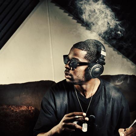 mc: man in music studio smoking weed