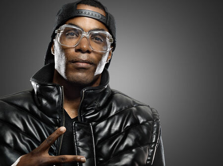 funky african american man with glasses on studio background. photo