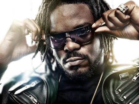 black man with cool sunglasses posing Stock Photo