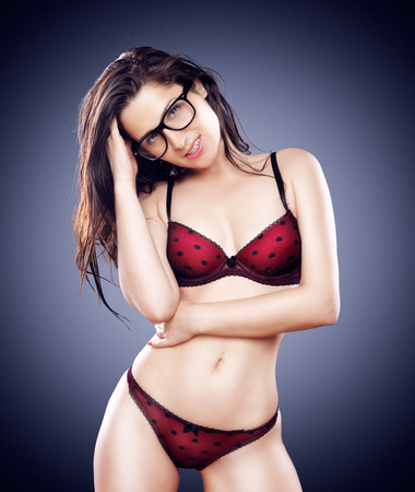 sexy hipster girl with glasses in lingerie photo