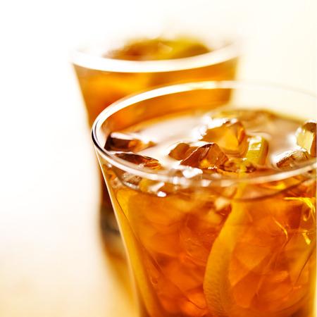 ice lemon tea: macro close up photo of a glass of iced tea