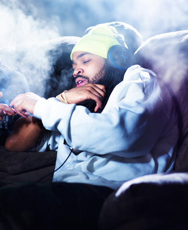 drug use: passing a joint and amid marijuana smoke clouds