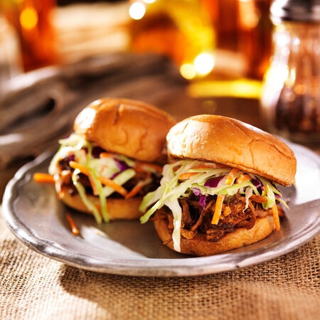 pulled pork sandwiches with bbq sauce and slaw photo