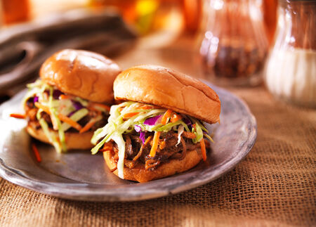 photo of two pulled pork sandwiches photo
