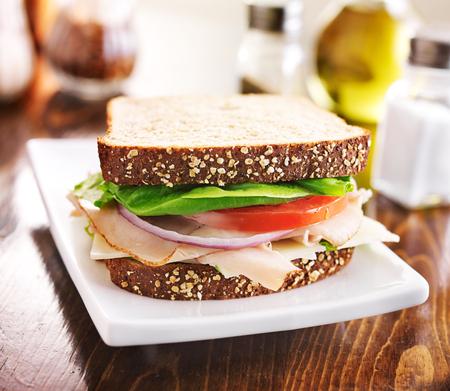 Deli: deli meat sandwich with turkey, tomato, onion, and lettuce