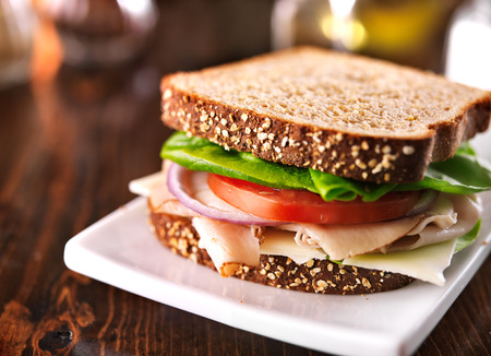 green wheat: cold cut turkey sandwich on whole wheat with swiss cheese