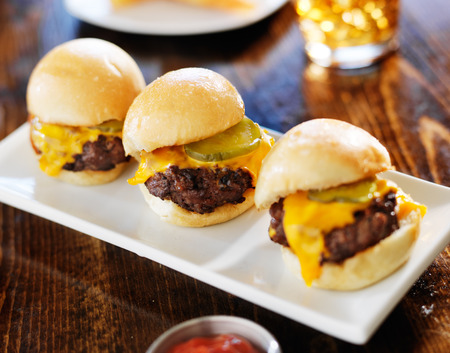 three mini burger sliders in a row photo