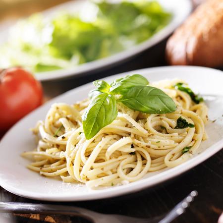 close up food: plate of italian spaghetti with pesto sauce