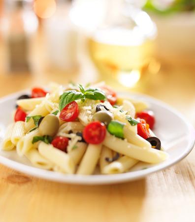 pasta salad: eating penne pasta salad with fork