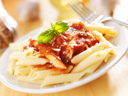 penne: plate of italian penne pasta in tomato sauce