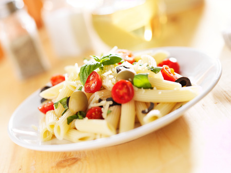 pasta salad: penne pasta salad with olives, tomatoes, and basil.