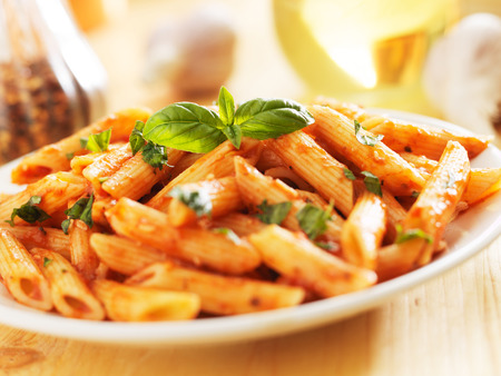 penne pasta smothered in tomato sauce photo
