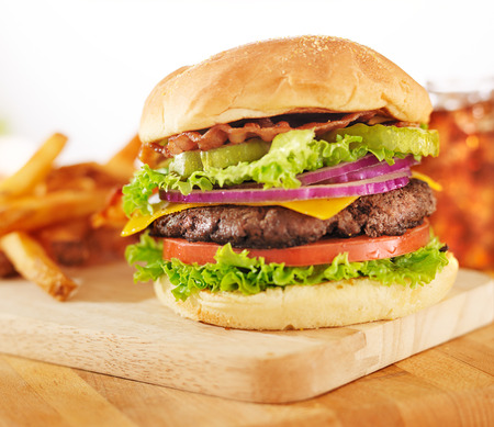 hamburger with french fries and soft drink photo