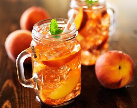 jar of peach tea shot with selective focus photo
