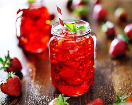 vivid red strawberry cocktail in a jar photo