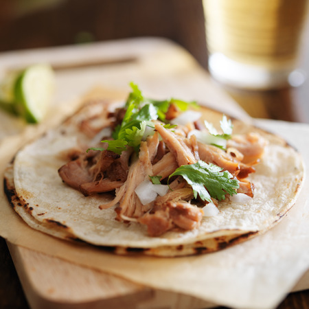 authentic mexican tacos with carnitas, cilantro and onion Stock Photo