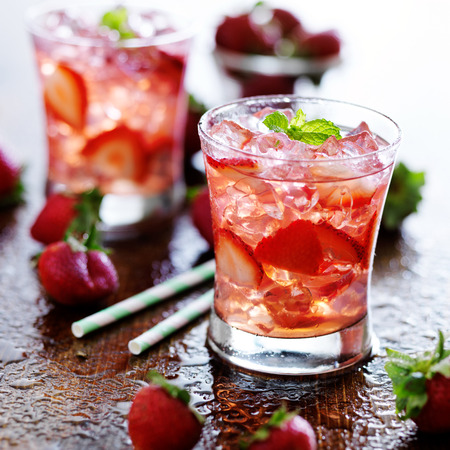 strawberry cocktail drink with ice and mint