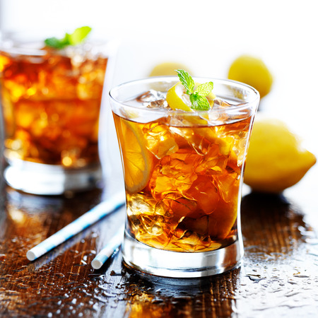 sweet tea with lemon slices and mint photo