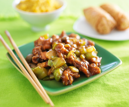 kung pao chicken on green plate. photo
