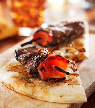kebob: sirloin steak mini kabobs with pita bread