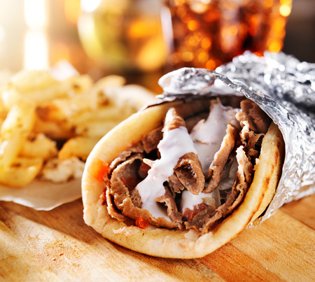 sandwich: greek gyro with fries close up