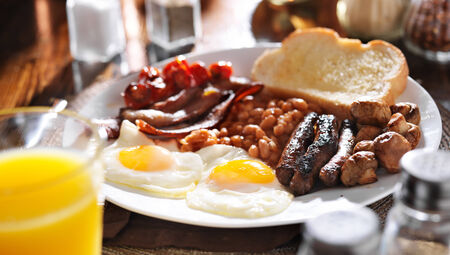 bacon baked beans: full english breakfast in panoramic composition