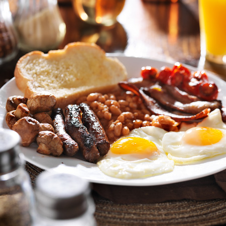 bacon baked beans: full english breakfast in square composition Stock Photo