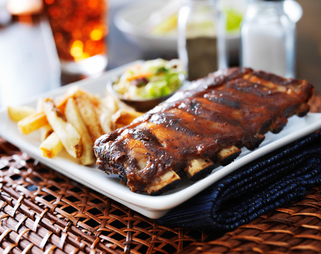 bbq ribs with cole slaw and french fries photo
