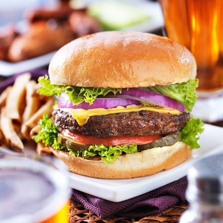 cheeseburgers: cheeseburger with beer and french fries close up