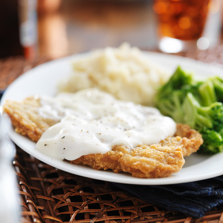 peppered: chicken fried steak with southern style peppered milk gravy Stock Photo