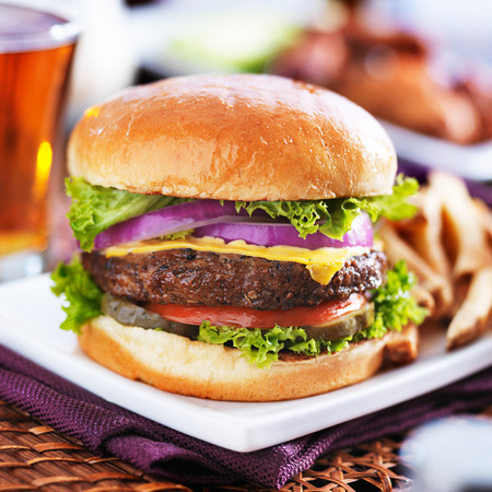french fries plate: cheeseburger with beer and french fries close up