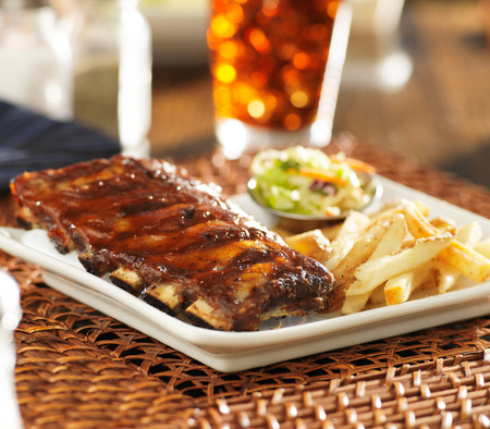 full rack of baby back ribs in barbecue sauce photo