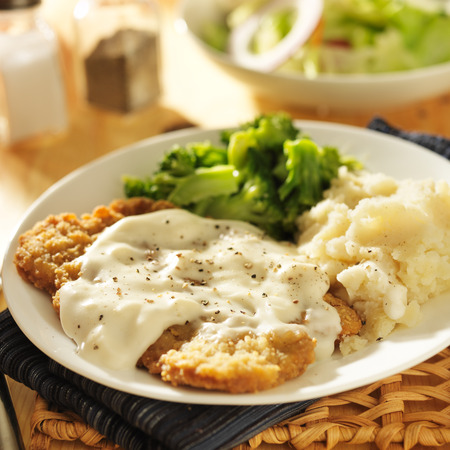 steak plate: country fried steak with southern style peppered milk gravy Stock Photo