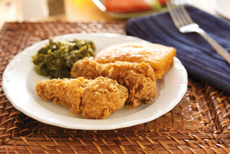 fried chicken with collard greens and corn bread panoramic shot photo