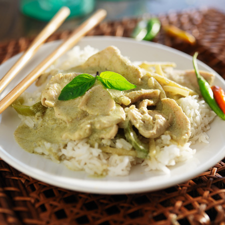 thai green curry with chicken on jasmine rice photo