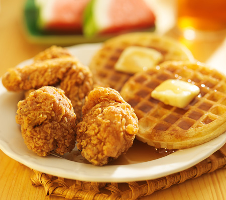 fried chicken & waffles with watermelon and sweet tea in background