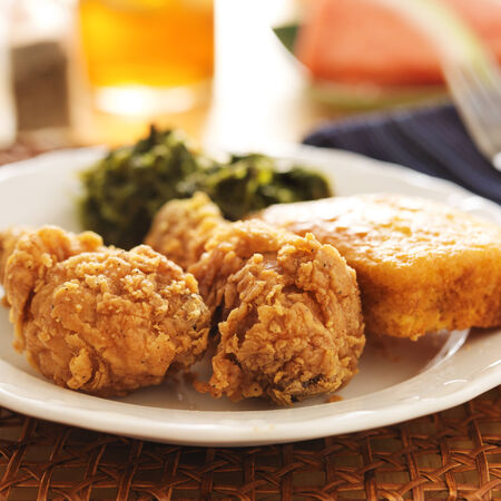 soul food - fried chicken with collard greens and corn bread photo