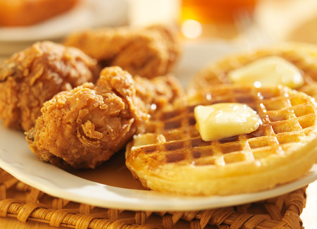 comfort food: fried chicken and waffles shot in panoramic format