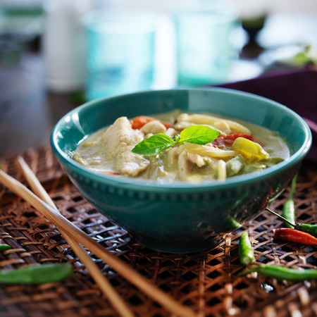 thai green curry with chicken in bowl photo