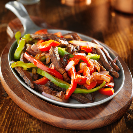 rustic food: mexican food - beef fajitas and bell peppers Stock Photo