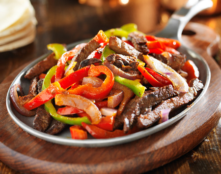 mexican food - beef fajitas and bell peppers photo