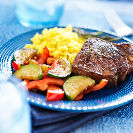 steak with vegetables and rice dinner photo