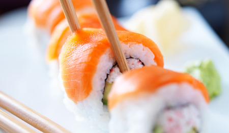 eating sushi with chopstricks panorama