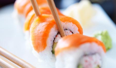 sushi plate: eating sushi with chopstricks panorama