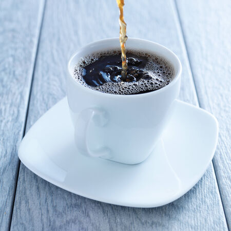 light slate gray: pouring hot coffee into cup