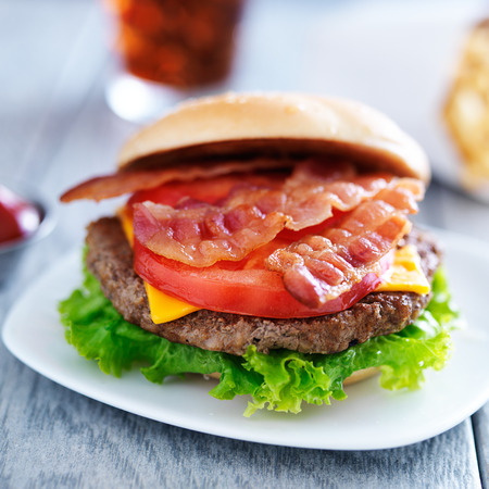 bacon chesseburger with fries and cola photo