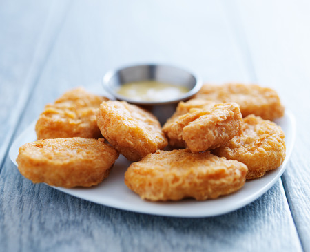 nuggets: chicken nuggets with honey mustard in natural light Stock Photo